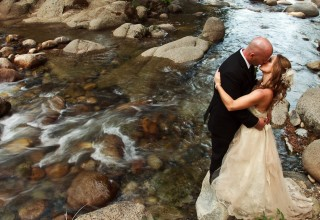 Bride and Groom by river in Yosemite